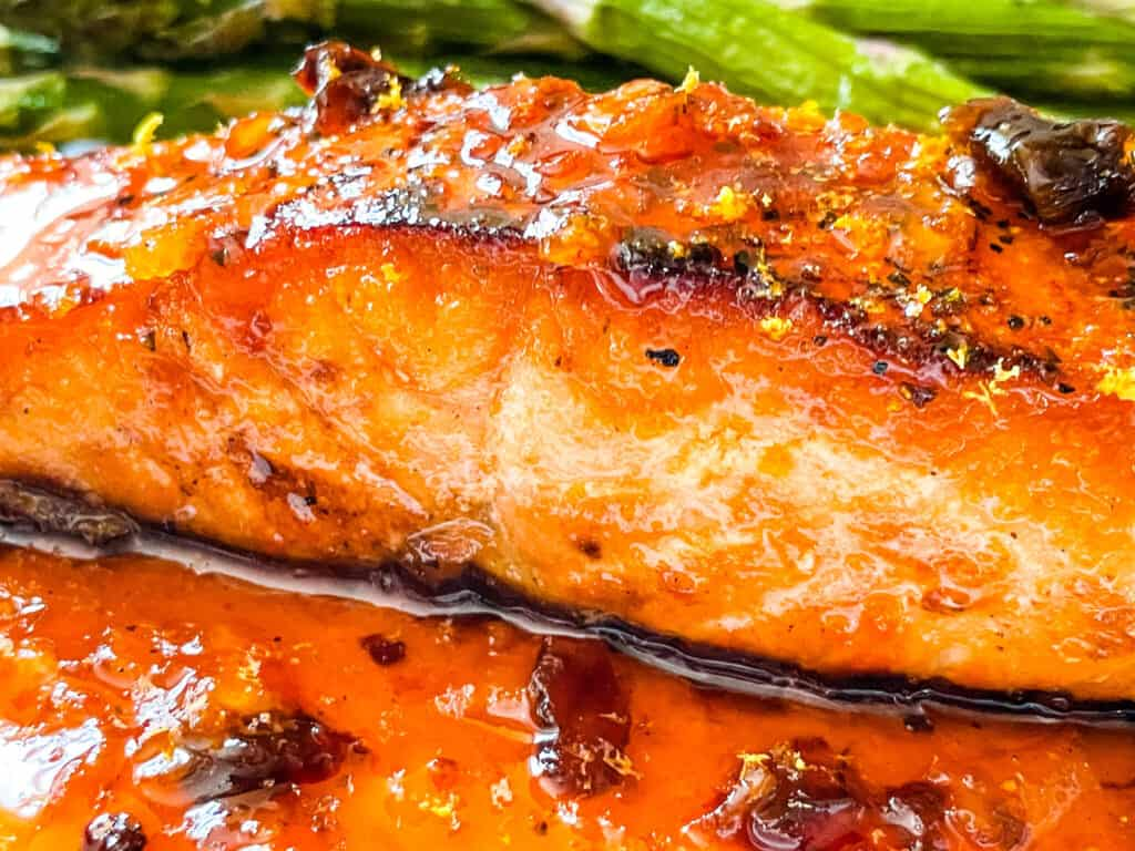Side view of a fish steak with the sauce under it