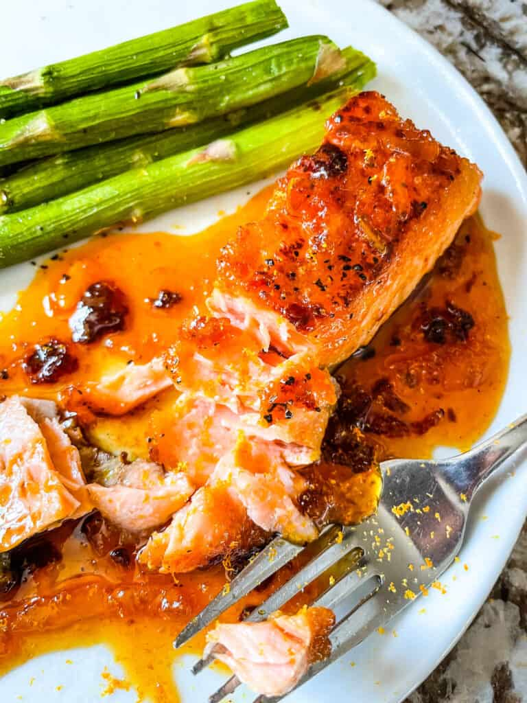 A pieve of Chipotle Orange Glazed Salmon partially eaten