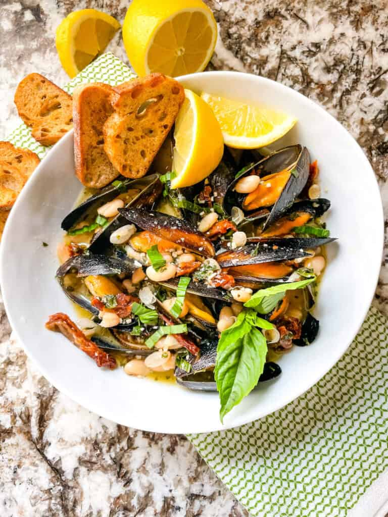 Top view of a bowl of Copycat Maggiano's Tuscan Mussels