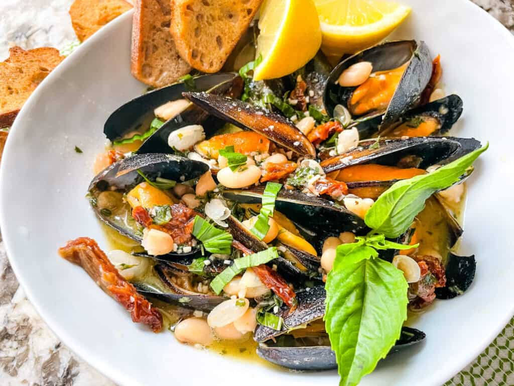A bowl of the shellfish and sauce