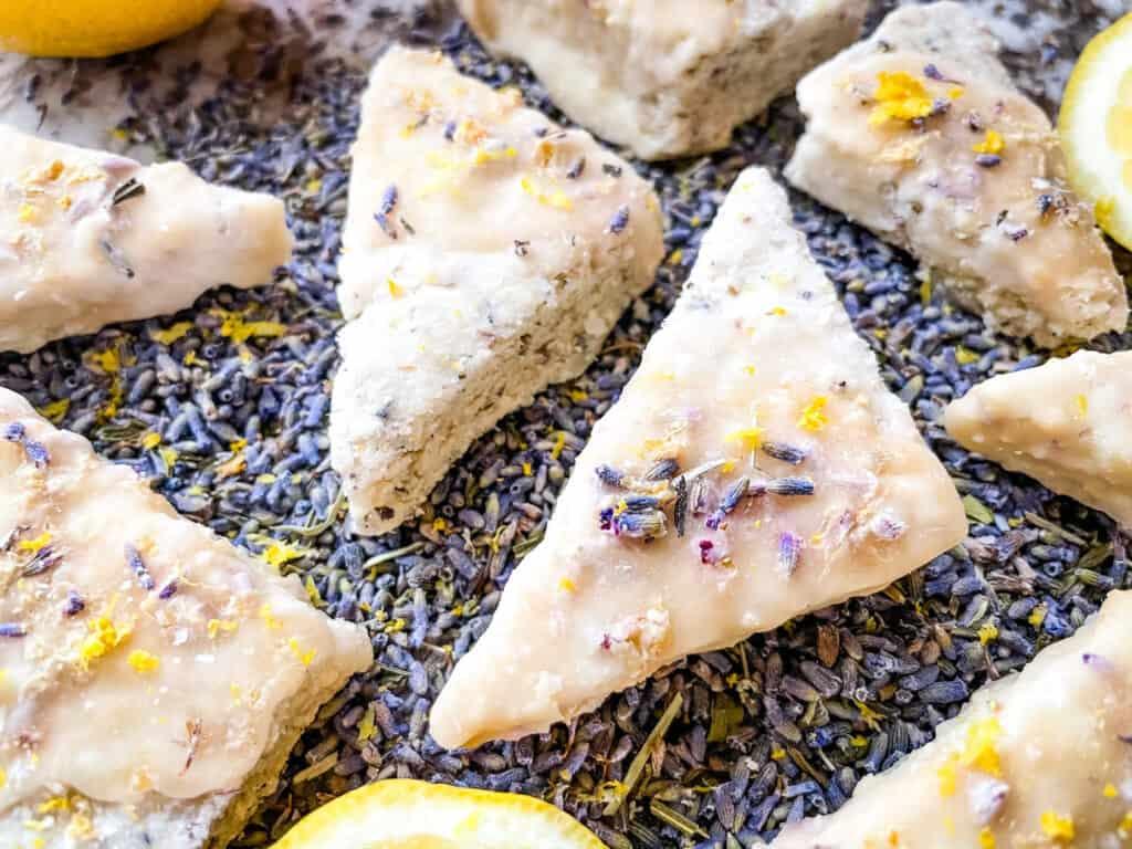 A bunch of Lemon Lavender Shortbread Cookies spread out over lavender flowers