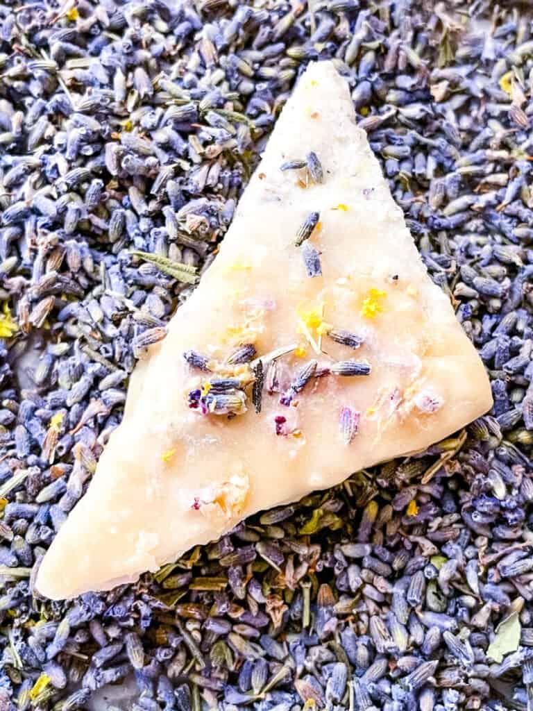 A single triangular cookie on the purple flower buds