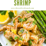 Pin image of Lemon Pepper Shrimp piled on a plate with title at top