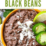 Pin image for Black Refried Beans in a yellow bowl with title at top
