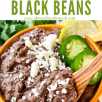 Pin image of Black Refried Beans in a bowl with wood spoon and title at top