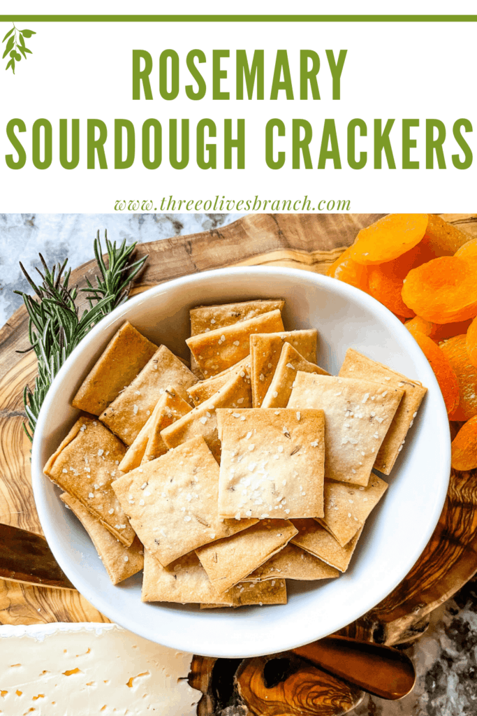 Pin image for Rosemary Sourdough Crackers on a charcuterie cheese board with title at top