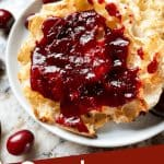 Pin image for Cranberry Jam with jam on an English muffin and title at bottom