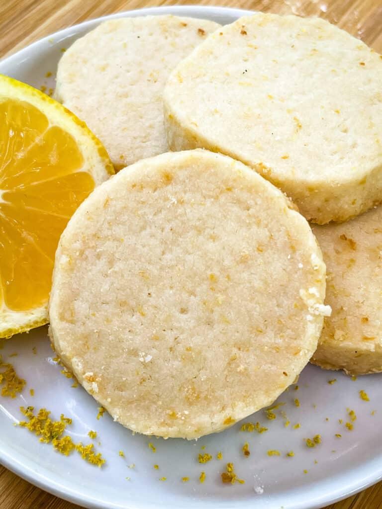 A pile of Lemon Shortbread on a plate without glaze