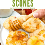 Pin image of a hand drizzling honey on Peach Scones with title at top