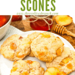 A pile of Peach Scones on a white plate with title at top