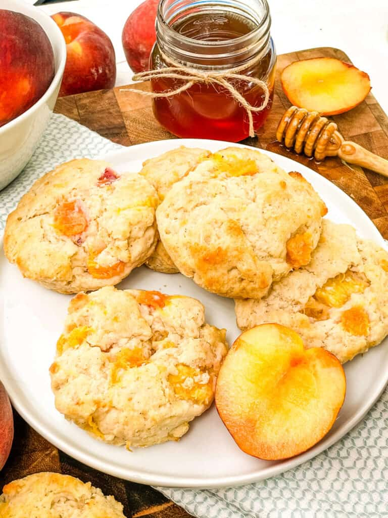 Peach Scones stacked on a white plate