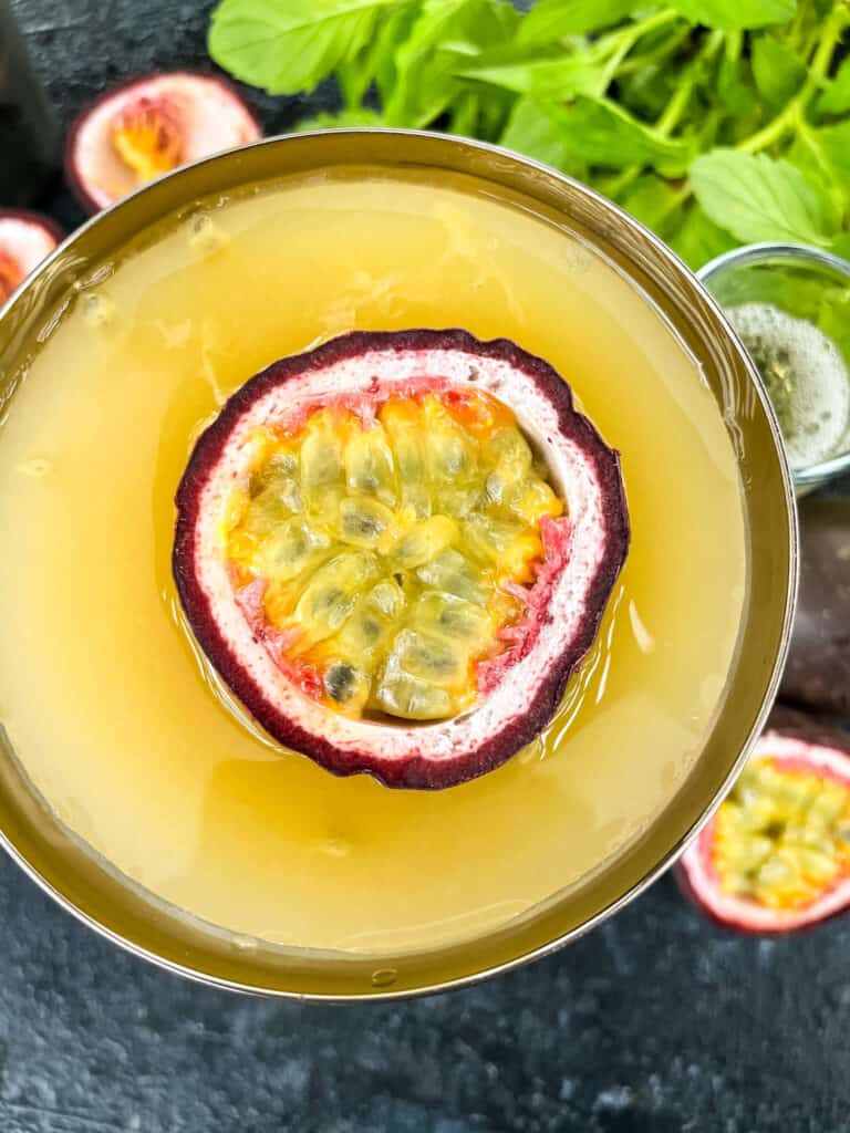 Close up top view of Pornstar Martini with passion fruit floating in it