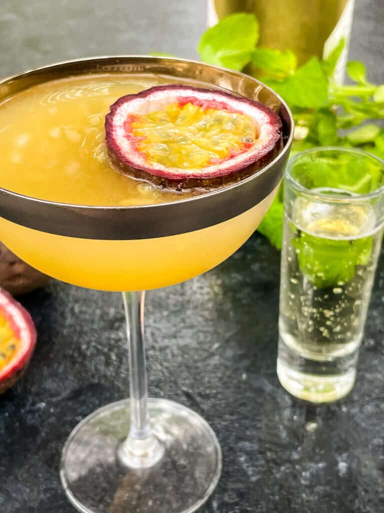 The Pornstar Martini with fruit floating in it