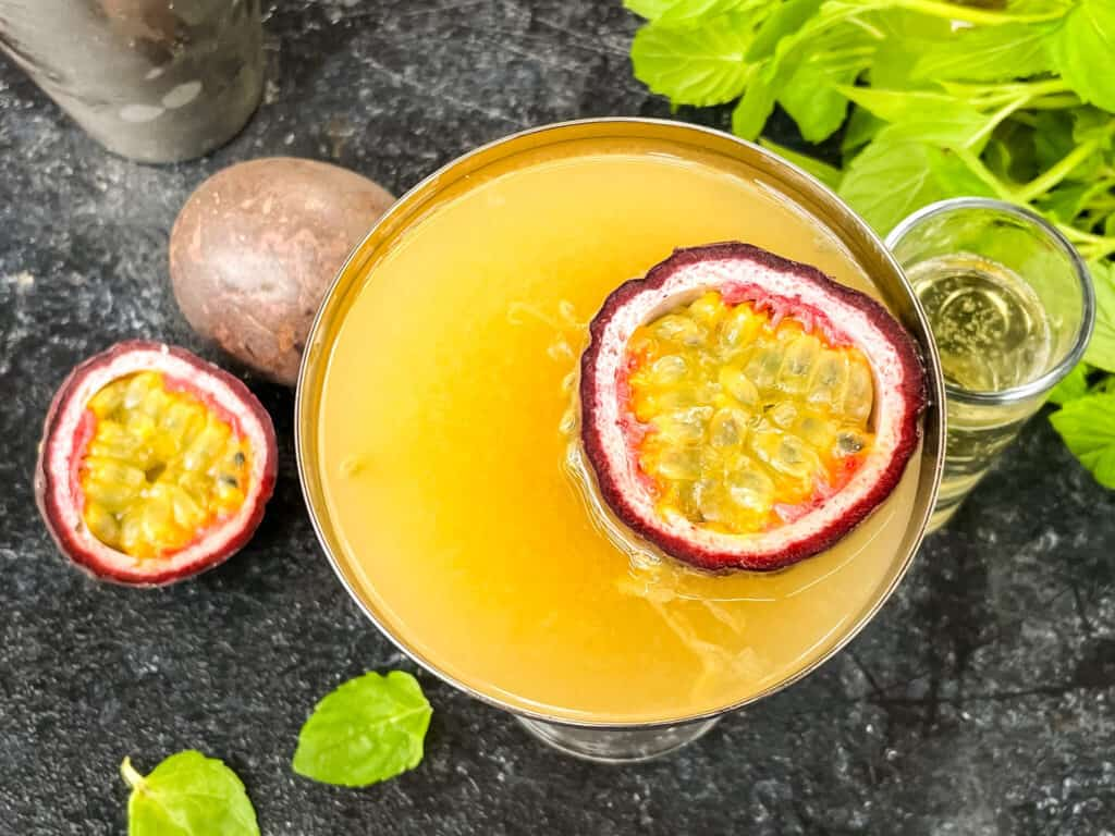 Top view of Pornstar Martini with passion fruit floating in it