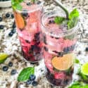 Two glasses of Blueberry Mojito cocktails