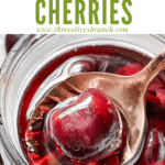 Pin image of a spoon scooping a Brandied Cherries with title at top