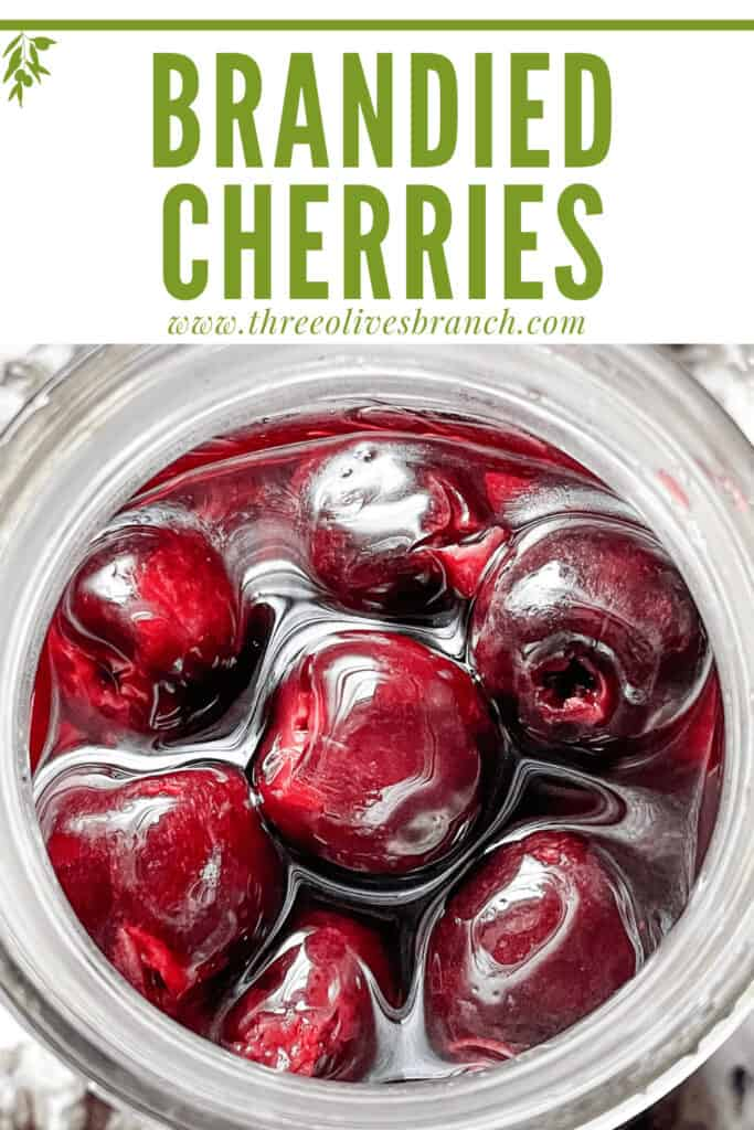 Pin image of top view of Brandied Cherries in a jar with title at top