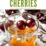 Pin image for Brandied Cherries on a cocktail with title at top