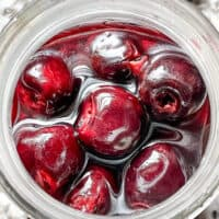 Top view of a jar full of Brandied Cherries