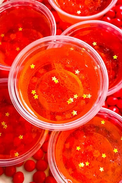 Close up of Fireball Jello Shots with gold star sprinkles