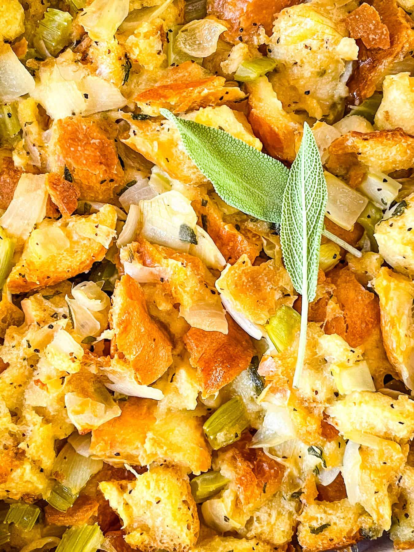 Close up of Onion and Sage Stuffing (Dressing) with sage leaves on top