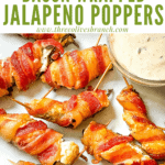 Pin image of Smoked Jalapeno Poppers on a white plate with title at top