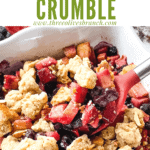 Pin image of a spoon scooping Apple and Blueberry Crumble out of the dish with title at top