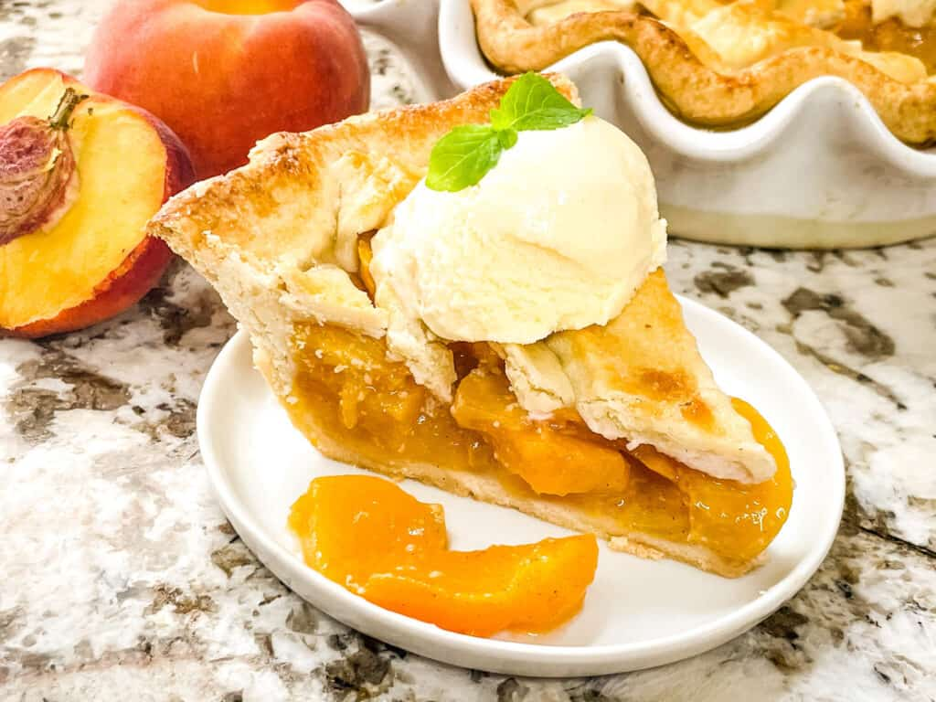 Peach pie with ice cream on a plate