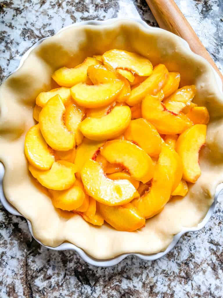 Top view of peach pie filling in a crust
