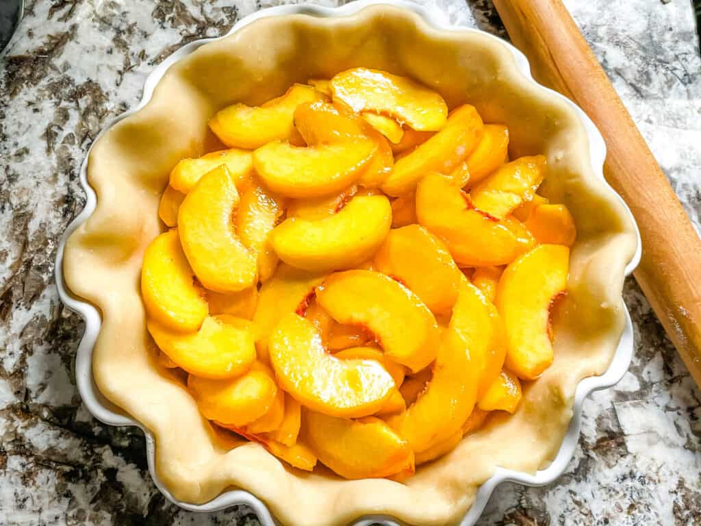 Pie crust filled with peach pie filling