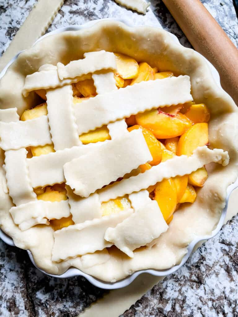 Lattice top being put on the pie