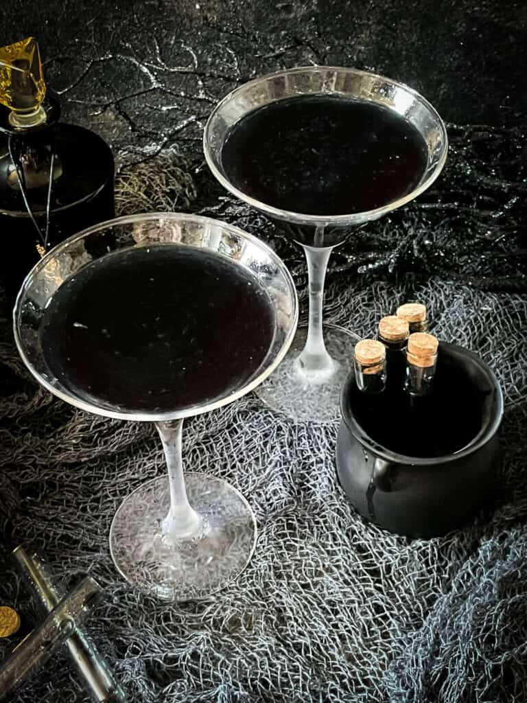 Two black Poison Apple Halloween Cocktails