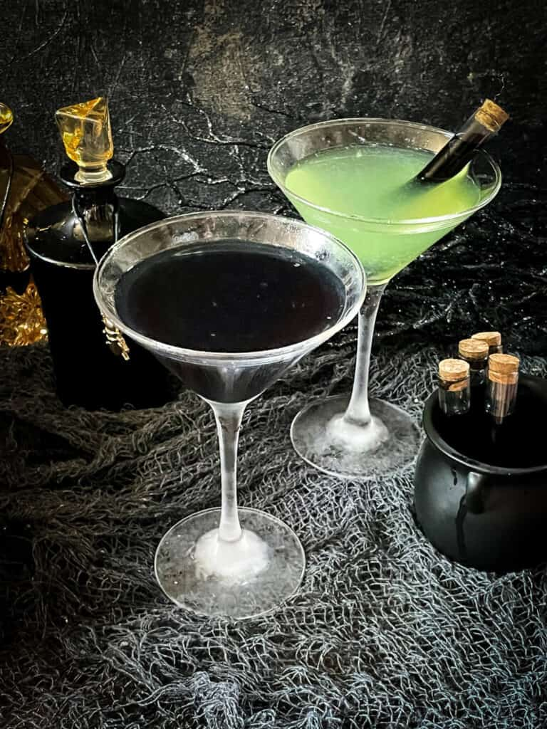 One black cocktail and one green Poison Apple Halloween Cocktail