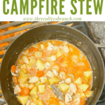 Pin image of Chicken Campfire Stew cooking on a fire with title at top