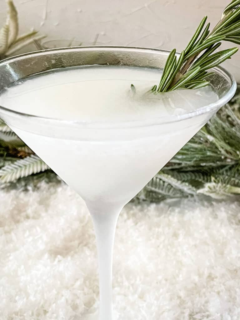 Closer side view of the drink with rosemary sticking out of it
