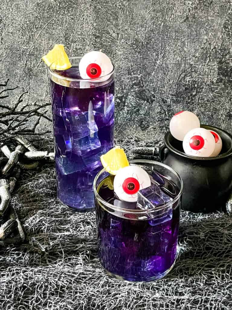 Two purple drinks decorated with eyes