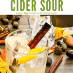 Pin image of Whiskey Cider Sour being poured with title at top