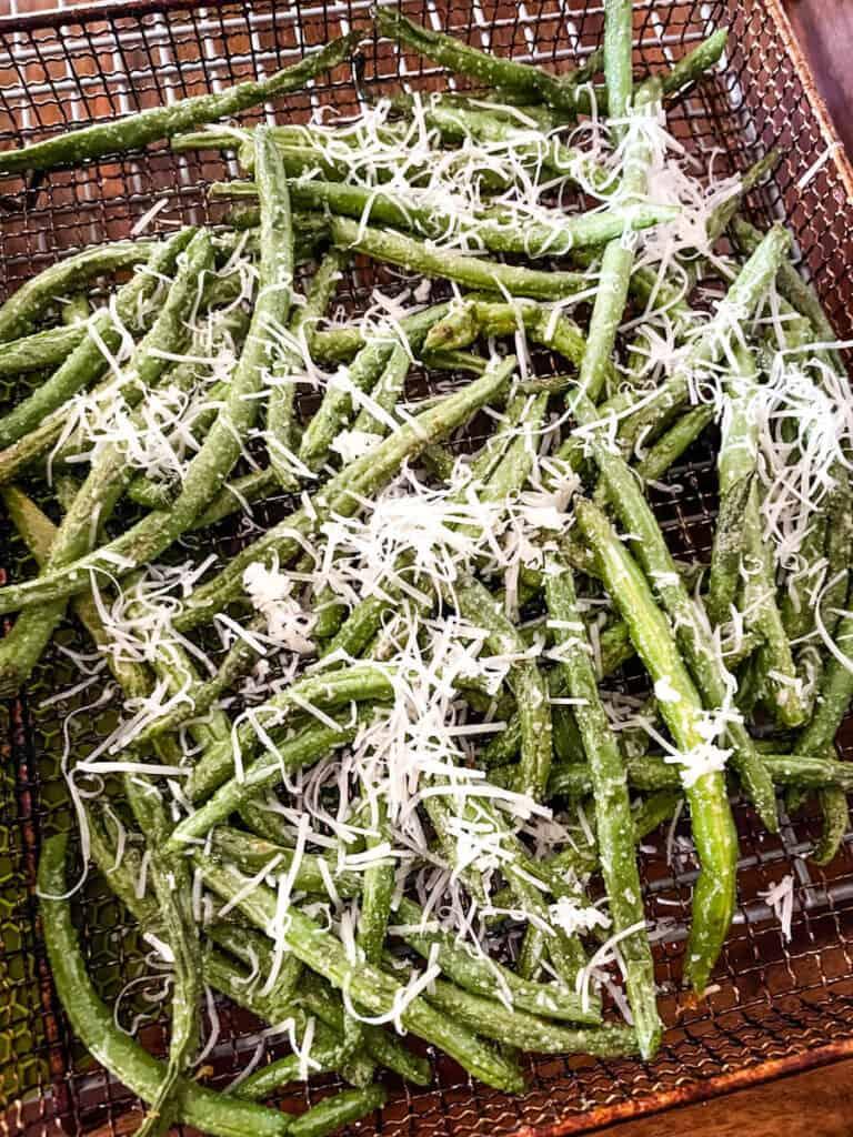 Parmesan Garlic Air Fryer Green Beans half way through cooking in the air fryer