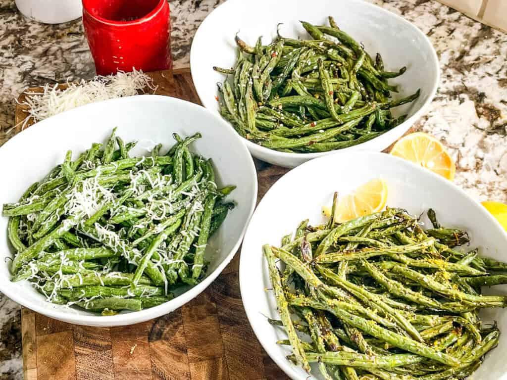 Air Fryer Green Beans (3 Ways) in three different white bowls