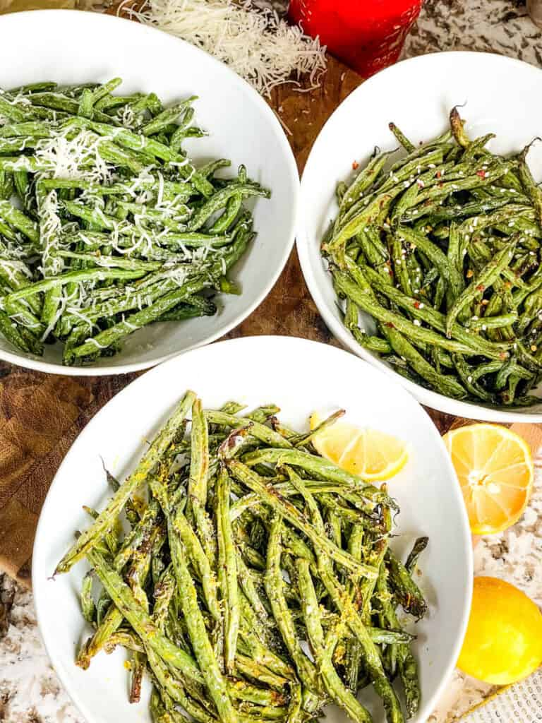 Three bowls full of the Air Fryer Green Beans (3 Ways) flavors