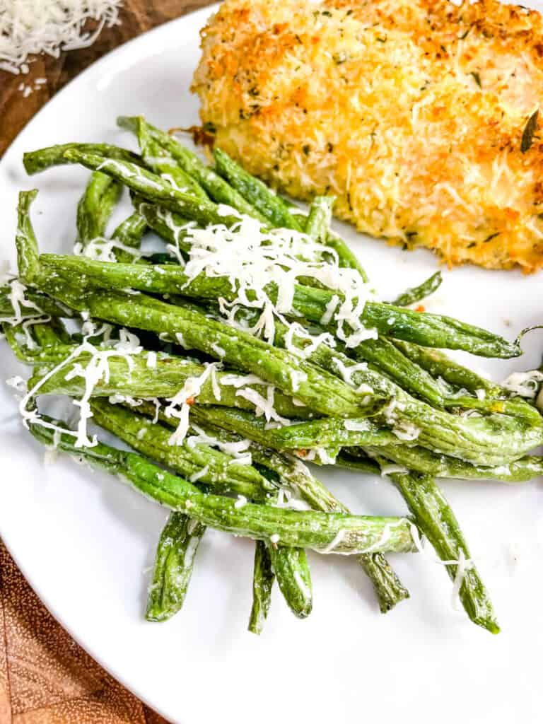 Parmesan Air Fried Green Beans on a plate with chicken