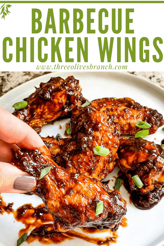Pin image of a hand grabbing a Barbeque Chicken Wing with title at top
