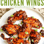 Pin image top view of Barbeque Chicken Wings on white plate with title at top