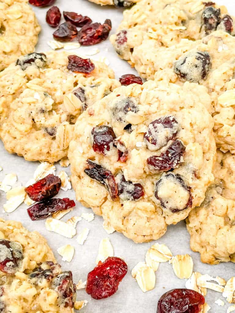 A close up of Oatmeal Craisin Cookies in a pile