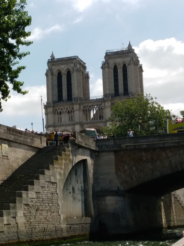 Notre Dame from below with clouds in the background