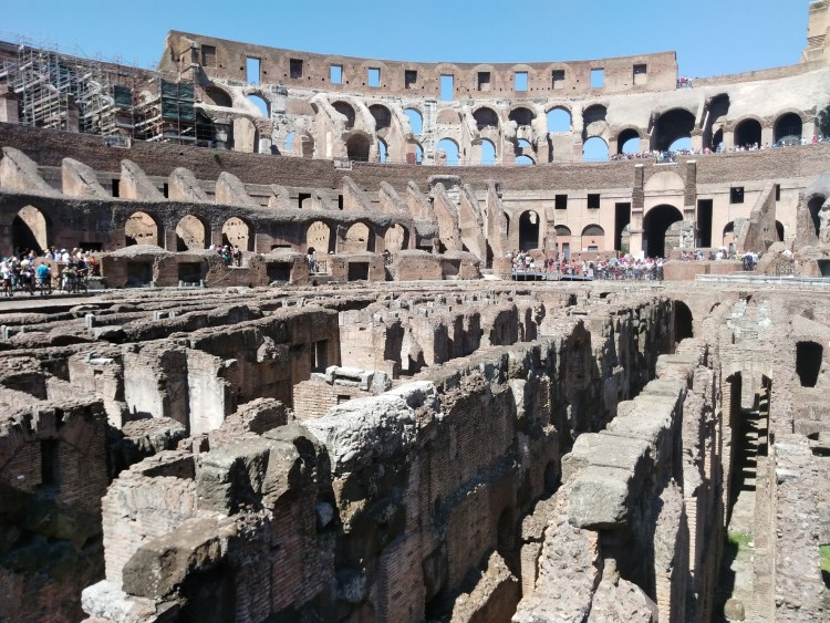 Center of the Colosseum, sunny day with views of the ancient walls