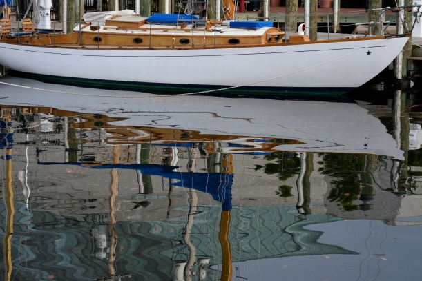Reflection of sailboat at Annapolis MD Photo by Mike Hartley