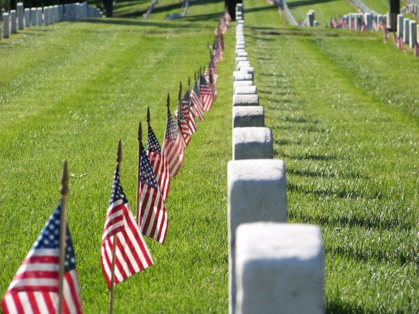 Flags lined headstones at Arlington National Cemetery. Photo by Mike Hartley