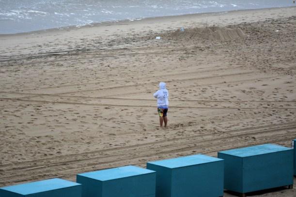 Loan figure on beach. Photo by Mike Hartley