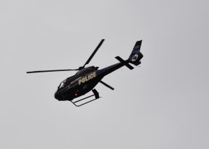 Baltimore Police chopper over Inner Harbor. Photo by Mike Hartley